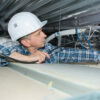 Worker performing task in confined space
